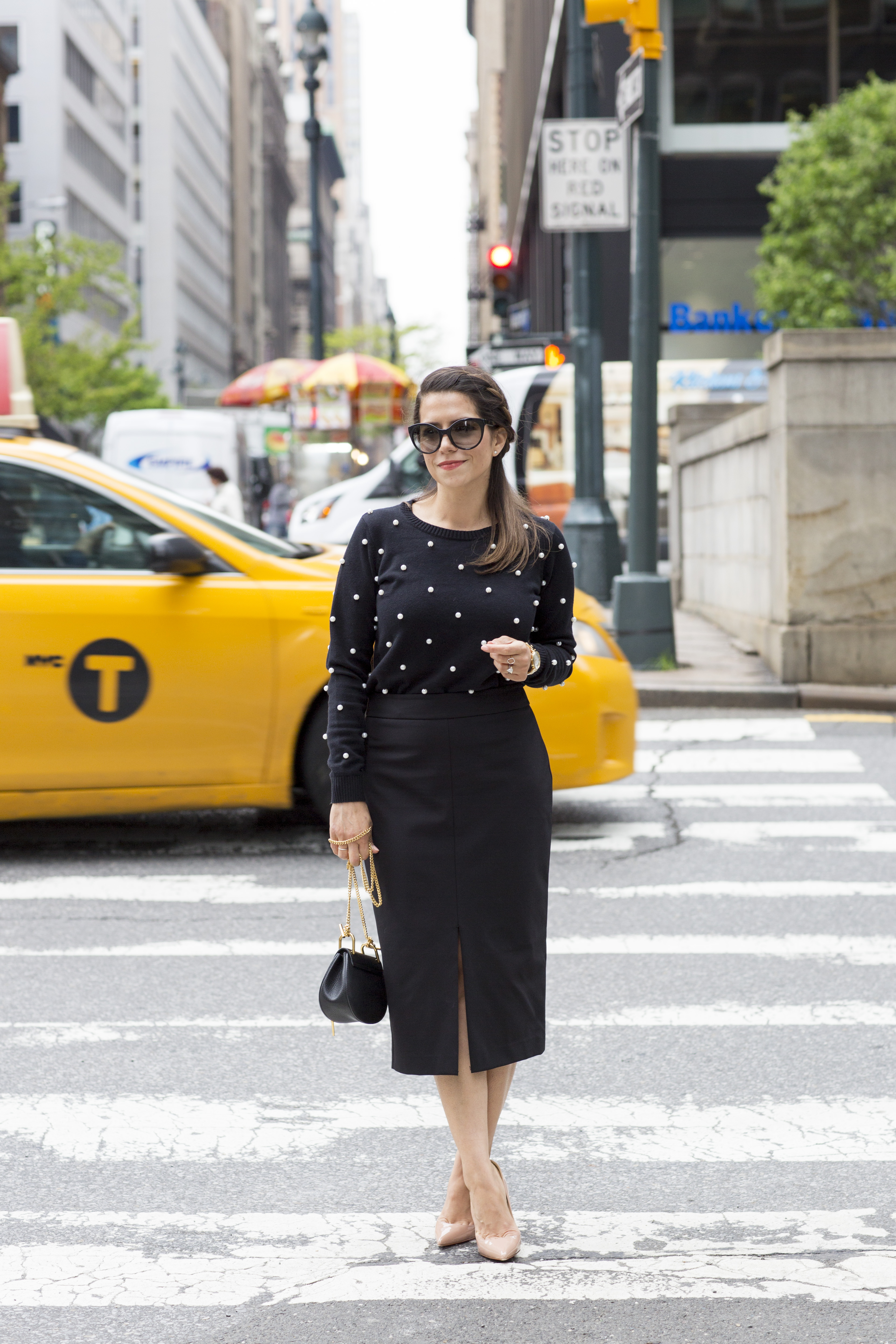 polka dot sweater with black midi skirt wearing in the spring by corporate catwalk