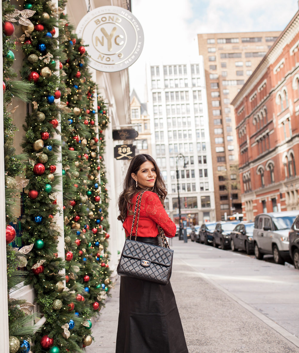 holiday party outfit, Sezane red adeline blouse, vintage chanel purse, french connection leather midi skirt, SJP embellished satin pumps, J.Crew pearl hoop earrings