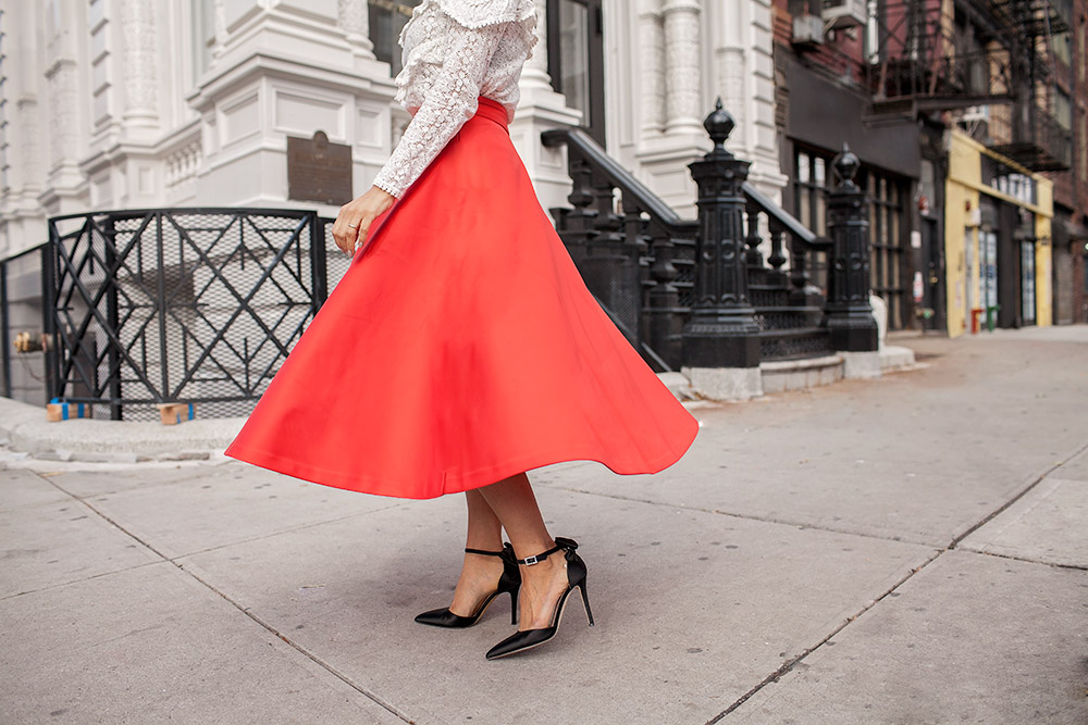 H&M red skirt and black SJP bow heels
