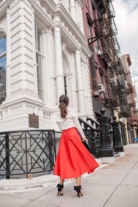 Red H&M skirt and black SJP bow heels Sezane ninon blouse