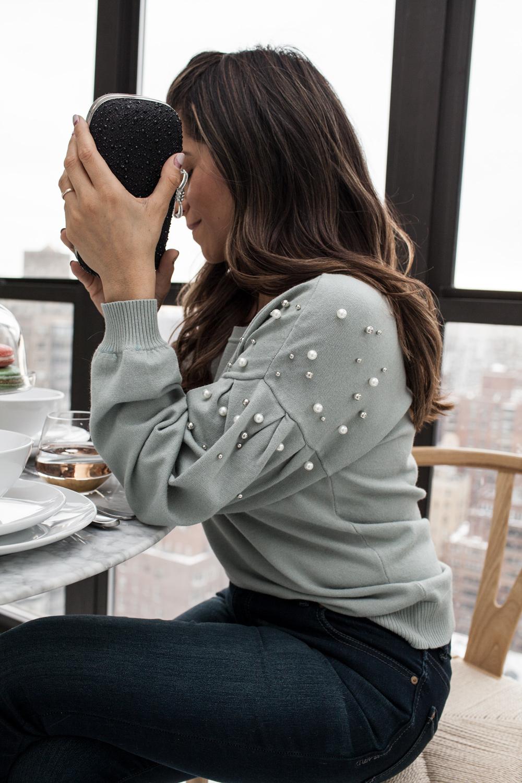 INC pearl detail sweater, shimmer clutch, dark wash denim